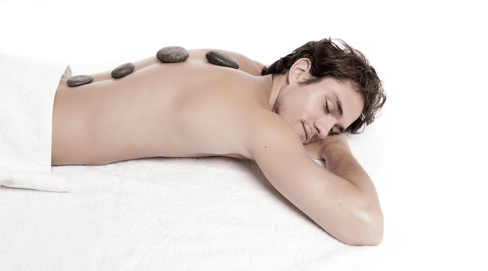 http://www.dreamstime.com/royalty-free-stock-photos-man-receiving-hot-stone-massage-young-male-adult-laying-down-image30435588
